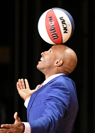 Former Harlem Globetrotter Derick Grant opened his remarks at the 40th annual City-Wide Celebration of Dr. Martin Luther King Jr. with a series of tricks with a basketball.