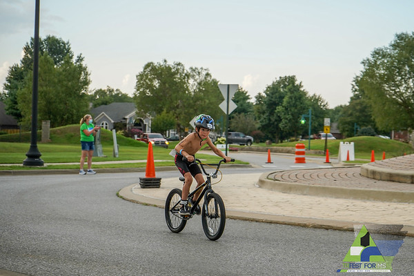 Despite the COVID climate of races canceling or going virtual, 2020's Trifest for MS took the required precausions and was granted in-person participation.  Smiles reflecting in everyone's eyes, Friday night kicked-off with the youth and 5k events.