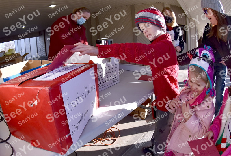 -Messenger photo by Britt Kudla<br /> Beckett Miles of Manson slide a letter into a box marked for Santa during Manson Christmas Parade on Saturday