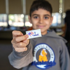 "Luis Flores proudly displays his ""I Voted"" sticker at Sierra 2 Center on March 3, 2020. (Photo by Joan Cusick)"