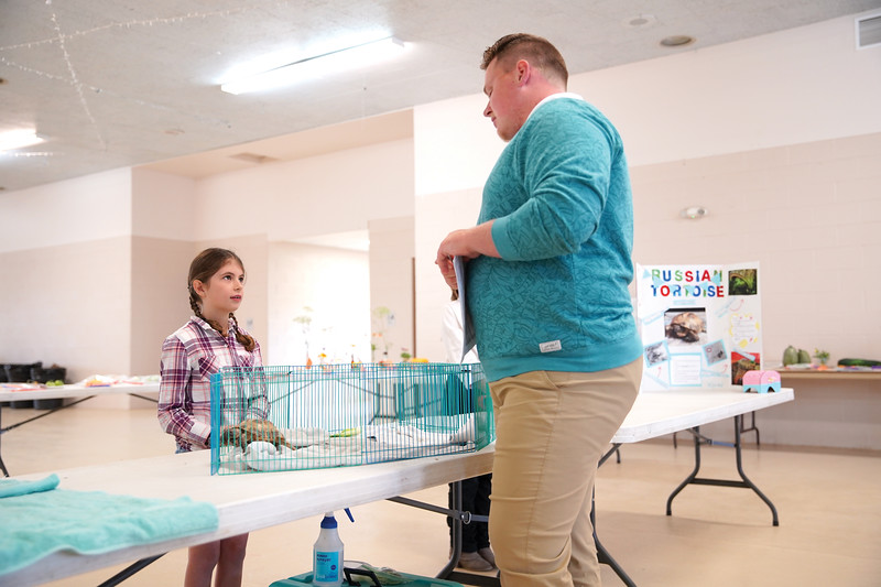 Matthew Gaston | The Sheridan Press   <br /> Laura Alliot, 10, answers questions pertaining to the daily care of her Russian tortoise for Sheridan County Fair judge Tom Terry during the pocket pets competition Wednesday, July 29, 2020.