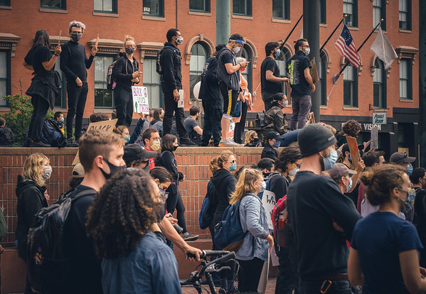 Protesters wear masks while gathering in downtown Boston