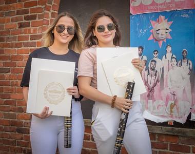 Suffolk University graduates Maddy Souza and Jennifer Vieira