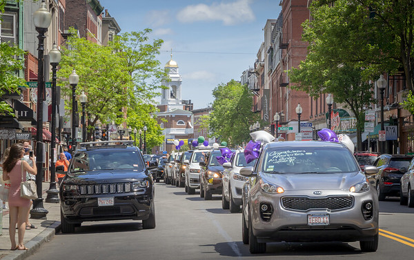 Rolling graduation parade makes it way down Hanover St. in Boston's North End