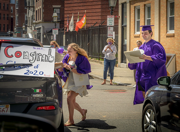 Boston Latin School graduates meet the rolling parade