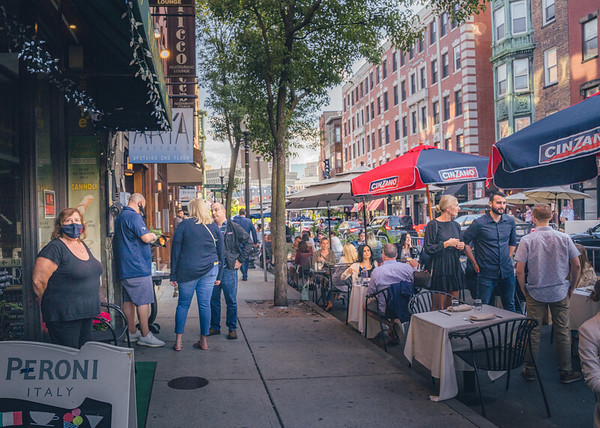 Caffe tables moved to the curb on Hanover Street