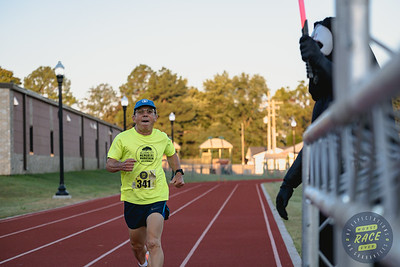 Runners got to experience a new course, starting & ending at the newly renovated Tiger Track in Bentonville, for Run Bentonville's Worst Race Ever.