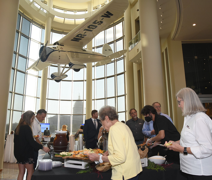 """Guests and honorees enjoy refreshments under the """"Winnie Mae"""" during the Journal Record 2021 Excellence in Construction and Real Estate reception, held at the Oklahoma History Center, 9-9-2021.  Photo by Mark Hancock"""