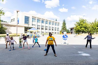 UAF alumna, Ray Alda, 21, leads a line dance during the 2021 UAF Alumni Association's reunion festivities.