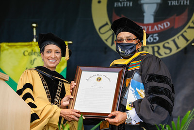 Bowie State University President Dr. Aminta H. Breaux presents the Presidential Medal of Excellence to Major Riddick Jr at the Spring 2021 commencement, Friday, May 21, 2021.