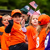 Harper Ryder and fellow members of the Cal Ripken League wave from their float.