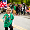 A member of the 4-H Moo Juicers hoists the flag proudly.