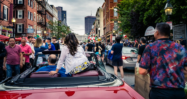 Backed up convertible traffic as the street celebrations continue in the North End