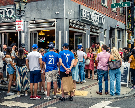 Crowds gather outside Bencotto restaurant with the game in progress