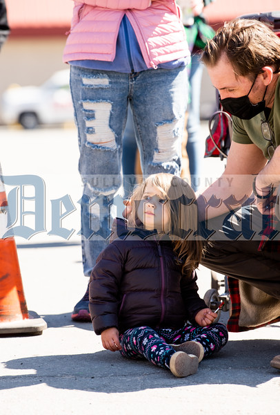 Emilia March had a prime seat right on the side of the road with dad Forbes helping her gather her candy!
