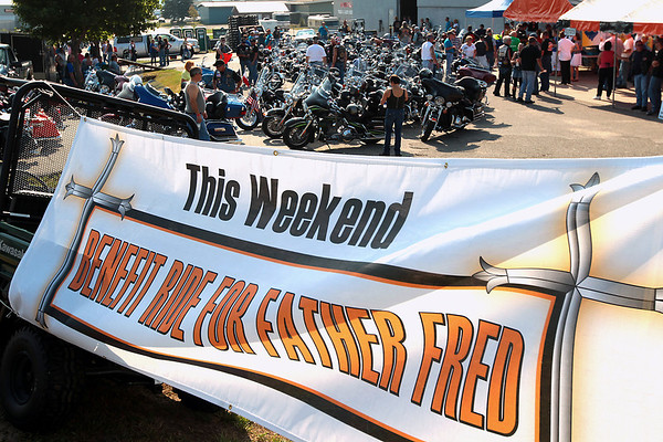 Record-Eagle/Keith King<br /> Motorcyclists gather at Classic Motor Sports Sunday, July 22, 2012 prior to the start of the 20th annual Ride for Father Fred to benefit the Father Fred Foundation. The event is sponsored by the Northern Chapter Harley Owners Group (HOG).