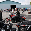 Record-Eagle/Keith King<br /> Alice Kukulski, of South Boardman, rides her motorcycle into Classic Motor Sports Sunday, July 22, 2012 prior to the start of the 20th annual Ride for Father Fred to benefit the Father Fred Foundation. The event is sponsored by the Northern Chapter Harley Owners Group (HOG).