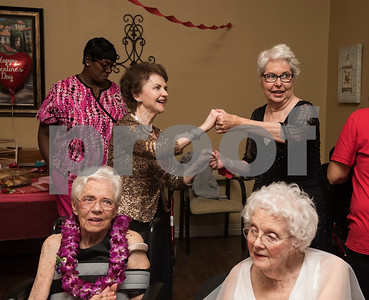 Community liaison JoAnne McMeans dances with resident Patricia Browning during the senior citizen's Valentine's Day prom held in the memory care unit at Prestige Estates Assisted Living and Memory Care in Tyler Tuesday Feb. 14, 2017.  (Sarah A. Miller/Tyler Morning Telegraph)