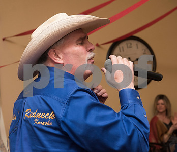 Jud Hagan sings along with Rippin' Redneck Karaoke at the senior citizen's Valentine's Day prom held in the memory care unit at Prestige Estates Assisted Living and Memory Care in Tyler Tuesday Feb. 14, 2017. The event featured karaoke and snacks, and many residents wore formal dresses.  (Sarah A. Miller/Tyler Morning Telegraph)