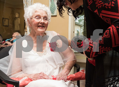 Volunteer Sam Edwards, right, visits with resident Patsy Lowe during the senior citizen's Valentine's Day prom held in the memory care unit at Prestige Estates Assisted Living and Memory Care in Tyler Tuesday Feb. 14, 2017. The event featured karaoke and snacks, and many residents wore formal dresses.  (Sarah A. Miller/Tyler Morning Telegraph)