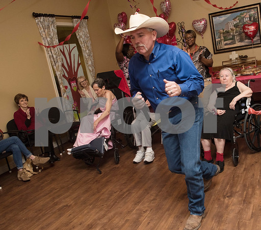 Jud Hagan of Rippin' Redneck Karaoke performs at the senior citizen's Valentine's Day prom held in the memory care unit at Prestige Estates Assisted Living and Memory Care in Tyler Tuesday Feb. 14, 2017. The event featured karaoke and snacks, and many residents wore formal dresses.  (Sarah A. Miller/Tyler Morning Telegraph)