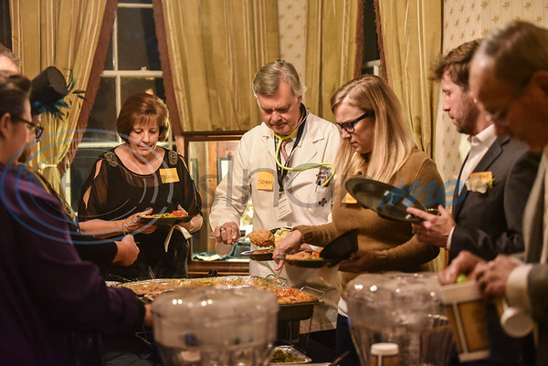 Guests make their dinner plates during a Valentine's Day themed murder mystery dinner titled A Table for None. The event took place at the Goodman-LeGrand Museum and was hosted by museum curator Mary Foster and catered by Traditions. (Jessica T. Payne/Tyler Morning Telegraph)