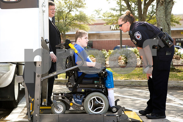 Tyler police officer Kerri Long chats with Ben Hall Hastings, 9, as Ben boards his shuttle after lunch at Chick-Fil-A as part of a Make-A-Wish event for Ben in Tyler, Texas, on Saturday, Feb. 18, 2017. Ben's wish also involved a shopping spree at Game Stop and Best Buy. (Chelsea Purgahn/Tyler Morning Telegraph)