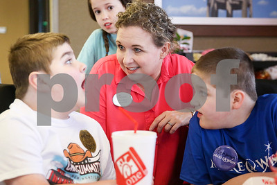 Douglas Hall Hastings, 10, left, chats with Chick-Fil-A employee Marcy Myers and Douglas' brother Ben, 9, during lunch at Chick-Fil-A as part of a Make-A-Wish event for Ben in Tyler, Texas, on Saturday, Feb. 18, 2017. Ben's wish also involved a shopping spree at Game Stop and Best Buy. (Chelsea Purgahn/Tyler Morning Telegraph)
