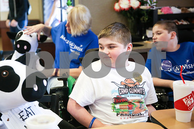 Douglas Hall Hastings, 10, glances over at his new Chick-Fil-A cow during lunch at Chick-Fil-A as part of a Make-A-Wish event for Ben in Tyler, Texas, on Saturday, Feb. 18, 2017. Ben's wish also involved a shopping spree at Game Stop and Best Buy. (Chelsea Purgahn/Tyler Morning Telegraph)