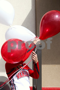 A Van High School cheerleader holds onto balloons as the wind blows during lunch at Chick-Fil-A as part of a Make-A-Wish event for Ben Hall Hastings, 9, in Tyler, Texas, on Saturday, Feb. 18, 2017. Ben's wish also involved a shopping spree at Game Stop and Best Buy. (Chelsea Purgahn/Tyler Morning Telegraph)