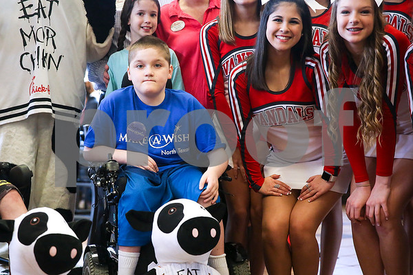 Ben Hall Hastings, 9, poses for a picture with Van High School cheerleaders and others during lunch at Chick-Fil-A as part of a Make-A-Wish event for Ben in Tyler, Texas, on Saturday, Feb. 18, 2017. Ben's wish also involved a shopping spree at Game Stop and Best Buy. (Chelsea Purgahn/Tyler Morning Telegraph)
