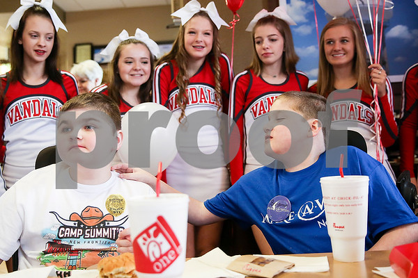 Ben Hall Hastings, 9, right, reaches over to his brother Douglas, 10, during lunch at Chick-Fil-A as part of a Make-A-Wish event for Ben in Tyler, Texas, on Saturday, Feb. 18, 2017. Ben's wish also involved a shopping spree at Game Stop and Best Buy. (Chelsea Purgahn/Tyler Morning Telegraph)