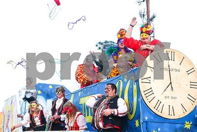 The Mystics of Time Mardi Gras Krewe throws beads and cups during Palestine's eighth annual Mardi Gras parade in Palestine, Texas, on Saturday, Feb. 18, 2017. Hundreds of people lined the streets to catch beads and watch floats, decorated cars and firetrucks drive along the parade route. (Chelsea Purgahn/Tyler Morning Telegraph)