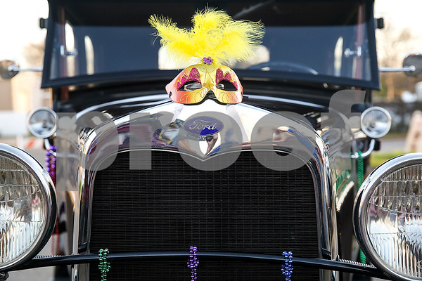 A Ford car decorated for Palestine's eighth annual Mardi Gras parade in Palestine, Texas, on Saturday, Feb. 18, 2017. Hundreds of people lined the streets to catch beads and watch floats, decorated cars and firetrucks drive along the parade route. (Chelsea Purgahn/Tyler Morning Telegraph)