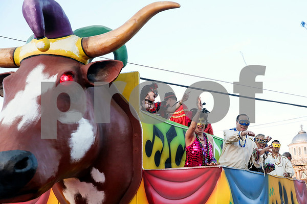 Parade participants throw beads to the crowd during Palestine's eighth annual Mardi Gras parade in Palestine, Texas, on Saturday, Feb. 18, 2017. Hundreds of people lined the streets to catch beads and watch floats, decorated cars and firetrucks drive along the parade route. (Chelsea Purgahn/Tyler Morning Telegraph)