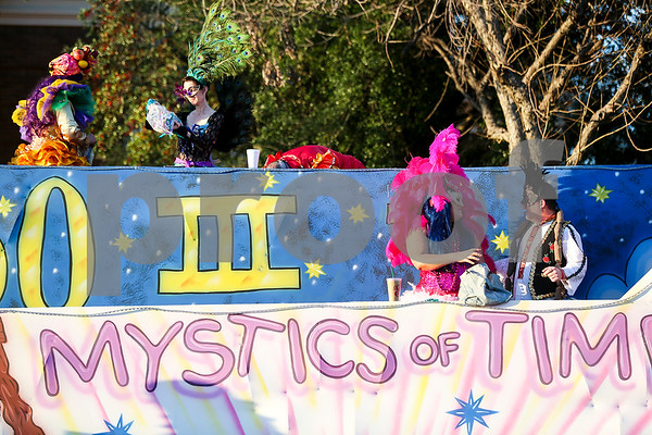 The Mystics of Time Mardi Gras Krewe prepares for Palestine's eighth annual Mardi Gras parade in Palestine, Texas, on Saturday, Feb. 18, 2017. Hundreds of people lined the streets to catch beads and watch floats, decorated cars and firetrucks drive along the parade route. (Chelsea Purgahn/Tyler Morning Telegraph)
