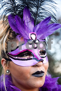 Jelissa Zator poses for a portrait during Palestine's eighth annual Mardi Gras parade in Palestine, Texas, on Saturday, Feb. 18, 2017. Hundreds of people lined the streets to catch beads and watch floats, decorated cars and firetrucks drive along the parade route. (Chelsea Purgahn/Tyler Morning Telegraph)
