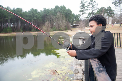 Noah Adams, 9, of Tyler, fishes at Woldert Park Pond Saturday Feb. 20, 2016. The pond, next to the Glass Recreation Center at 501 W. 32nd Street, is part of the Texas Parks and Wildlife.Tyler Parks and Recreation held a family fishing event at Woldert Park Pond Saturday that included goodie bags for children, free bait and instructional opportunities. The pond, located next to the Glass Recreation Center, is part of the Texas Parks and Wildlife Neighborhood Fishin' program and is stocked every two weeks with fish.  (Sarah A. Miller/Tyler Morning Telegraph)