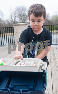 Junior Chapa, 4, of Tyler, looks through a tackle box as he fishes at Woldert Park Pond Saturday Feb. 20, 2016. The pond, next to the Glass Recreation Center at 501 W. 32nd Street, is part of the Texas Parks and Wildlife.Tyler Parks and Recreation held a family fishing event at Woldert Park Pond Saturday that included goodie bags for children, free bait and instructional opportunities. The pond, located next to the Glass Recreation Center, is part of the Texas Parks and Wildlife Neighborhood Fishin' program and is stocked every two weeks with fish.  (Sarah A. Miller/Tyler Morning Telegraph)