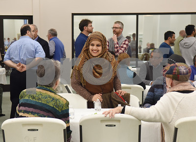 Shamsa Ashraf, center, walks with Sally Williams, at left, at the East Texas Islamic Society in Tyler Thursday Feb. 2, 2017. The gathering of East Texans of various faiths was in response to a private Facebook event called Support Our Muslim Neighbors. The event page asked people to bring yellow flowers and greeting cards to the mosque as a sign of friendship.   (Sarah A. Miller/Tyler Morning Telegraph)