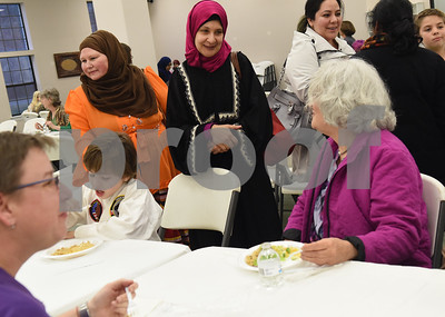 Aisha Hughes and Nilufer Erkin greet visitors during a public gathering at the East Texas Islamic Society in Tyler Thursday Feb. 2, 2017. The gathering of East Texans of various faiths was in response to a private Facebook event called Support Our Muslim Neighbors. The event page asked people to bring yellow flowers and greeting cards to the mosque as a sign of friendship.   (Sarah A. Miller/Tyler Morning Telegraph)