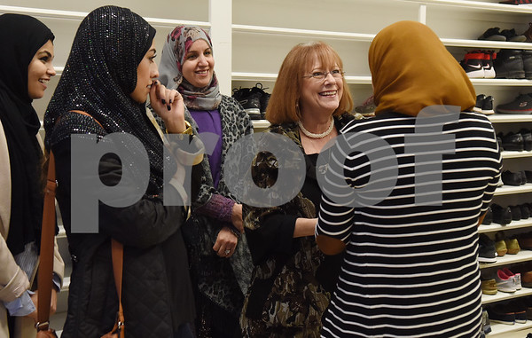 Asthma Kebir, far right, greets Pam Fields at the East Texas Islamic Society in Tyler Thursday Feb. 2, 2017. The gathering of East Texans of various faiths was in response to a private Facebook event called Support Our Muslim Neighbors. The event page asked people to bring yellow flowers and greeting cards to the mosque as a sign of friendship.   (Sarah A. Miller/Tyler Morning Telegraph)