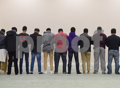 Men perform their evening prayer at the East Texas Islamic Society in Tyler Thursday Feb. 2, 2017. The gathering of East Texans of various faiths was in response to a private Facebook event called Support Our Muslim Neighbors. The event page asked people to bring yellow flowers and greeting cards to the mosque as a sign of friendship.   (Sarah A. Miller/Tyler Morning Telegraph)