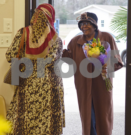 Rania Ali, left, welcomes Melody Cherry to the East Texas Islamic Society in Tyler Thursday Feb. 2, 2017. The gathering of East Texans of various faiths was in response to a private Facebook event called Support Our Muslim Neighbors. The event page asked people to bring yellow flowers and greeting cards to the mosque as a sign of friendship.   (Sarah A. Miller/Tyler Morning Telegraph)