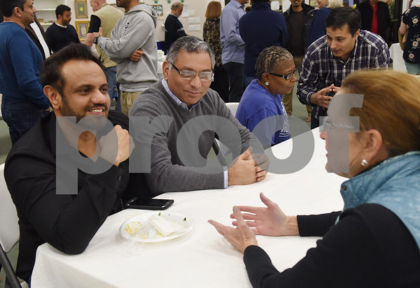 Noor Mohamed Osman and Nooralam Erkin talk with Anne McCrady at the East Texas Islamic Society in Tyler Thursday Feb. 2, 2017. The gathering of East Texans of various faiths was in response to a private Facebook event called Support Our Muslim Neighbors. The event page asked people to bring yellow flowers and greeting cards to the mosque as a sign of friendship. (Sarah A. Miller/Tyler Morning Telegraph)