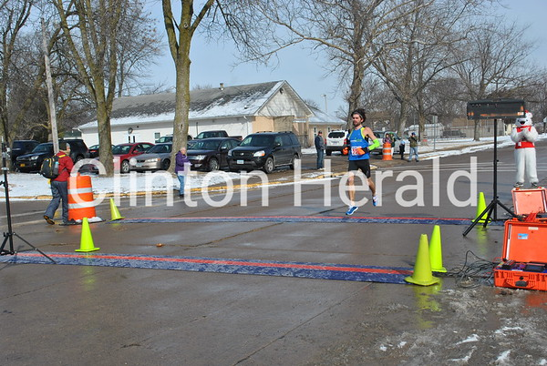 Tom Ries, of Iowa City, was the first person to cross the finish line Saturday at the 32nd annual B-rrry Scurry. • Samantha Pidde/Clinton Herald