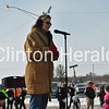 Ann Eisenman, from Clinton Community College, announced the runners and walkers as they came in during the B-rrry Scurry. • Samantha Pidde/Clinton Herald