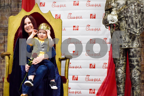 "Kalynne Arrick and her son Oliver, 2, pose for a photo during the Mother-Son Date ""Knight"" at the Tyler Rose Garden Center in Tyler, Texas, on Friday, Feb. 23, 2018. Families enjoyed a Chick-fil-A dinner made crafts as they watched knights battle. (Chelsea Purgahn/Tyler Morning Telegraph)"