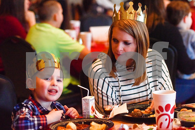 "Austin Crane, 4, and his mother Michelle enjoy dinner together during the Mother-Son Date ""Knight"" at the Tyler Rose Garden Center in Tyler, Texas, on Friday, Feb. 23, 2018. Families enjoyed a Chick-fil-A dinner made crafts as they watched knights battle. (Chelsea Purgahn/Tyler Morning Telegraph)"