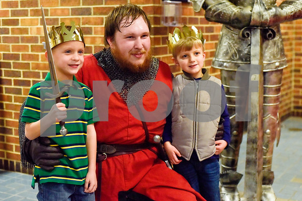 "Griffin Moon, 6, Evan Wilson and Gabe Smith, 5, pose for a photo during the Mother-Son Date ""Knight"" at the Tyler Rose Garden Center in Tyler, Texas, on Friday, Feb. 23, 2018. Families enjoyed a Chick-fil-A dinner made crafts as they watched knights battle. (Chelsea Purgahn/Tyler Morning Telegraph)"